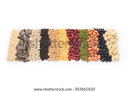 Vertical row of dry beans isolated on white background. - stock photo