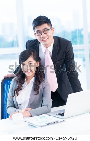 Vertical shot of a business team of two - stock photo