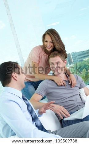 Vertical shot of a cheerful family meeting with the financial adviser - stock photo