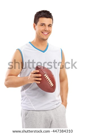 Vertical shot of a confident young man holding a football and looking at the camera isolated on white background - stock photo