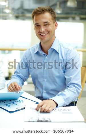 Vertical shot of a handsome businessman beaming with joy - stock photo