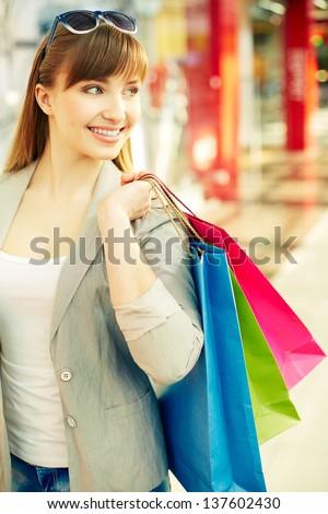 Vertical shot of a joyful consumer spending time shopping - stock photo