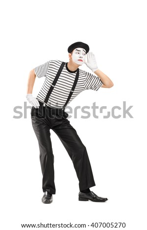 Vertical shot of a male mime artist trying to hear something isolated on white background - stock photo