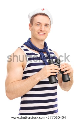 Vertical shot of a male sailor holding binoculars, smiling and looking at the camera isolated on white background - stock photo