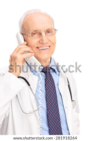 Vertical shot of a mature doctor speaking on a telephone and smiling isolated on white background - stock photo