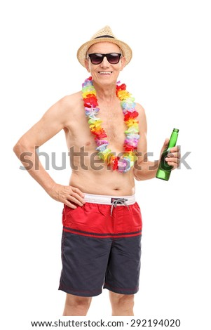Vertical shot of a senior man in a swim trunks holding a beer and looking at the camera isolated on white background