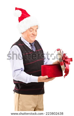 Vertical shot of a surprised senior opening a Christmas present isolated on white background - stock photo