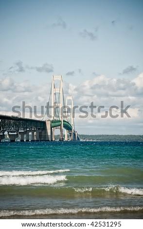 Vertical shot of a suspension bridge (Mackinac). The bridge connects upper Michigan to lower Michigan. - stock photo
