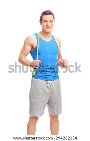 Vertical shot of a young male athlete posing with a skipping rope around his neck isolated on white background - stock photo