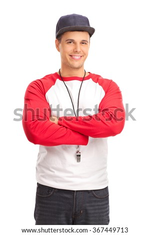 Vertical shot of a young male sports coach with a whistle around his neck isolated on white background