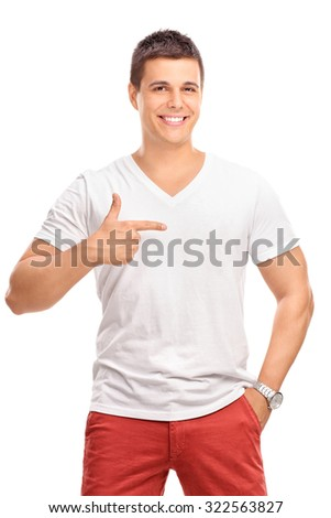 Vertical shot of a young man in a plain white shirt pointing with his finger to his left isolated on white background