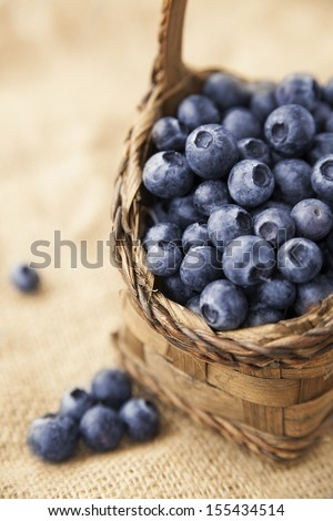 vertical shot of basket filled with ripe fresh blueberries - stock photo