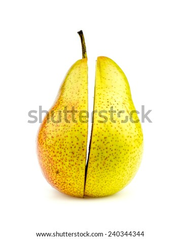 Vertical shot of colorful corella pear halves perfectly cut - stock photo