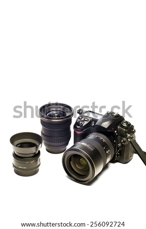Vertical Shot Of Digital Camera And Gear With Copy Space Above - stock photo