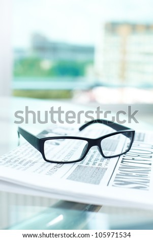 Vertical shot of the objects typical for business environment - stock photo
