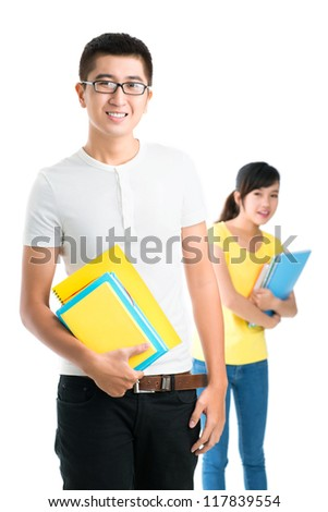 Vertical shot of two smiling students isolated against white background - stock photo