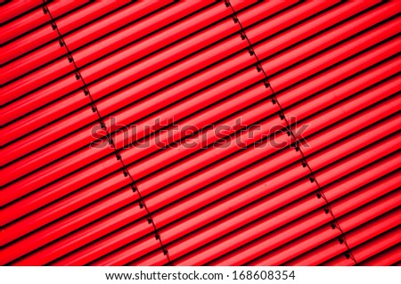 Vertical shutter blind in a factory window - stock photo