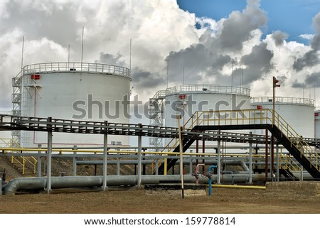 Vertical steel tanks for the storage of petroleum products. - stock photo
