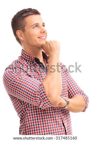 Vertical studio shot of a young man in a red checkered shirt looking up and contemplating isolated on white background - stock photo