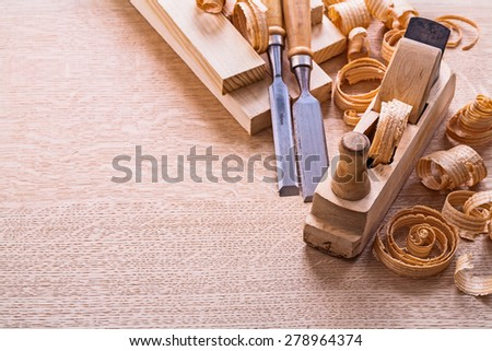 vertical version organized copyspace joinery tools old fashioned woodworkers plane chisels planks shawings  - stock photo