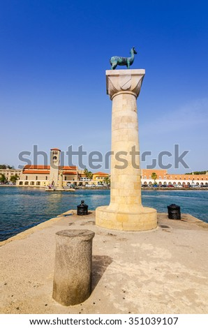Vertical view for deer statue in entry to Mandraki harbor