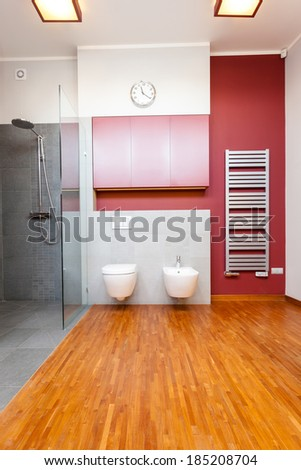 Vertical view of a bathroom with toilet and bidet
