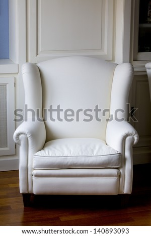 Vertical view of a white classic armchair. White Armchair.