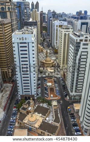 Vertical view of Abu Dhabi city, United Arab Emirates by day - stock photo