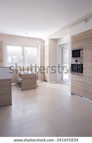 Vertical view of beige wall kitchen design - stock photo