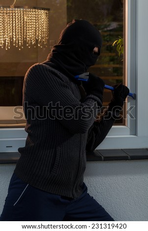 Vertical view of burglary into the house - stock photo