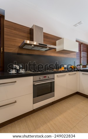 Vertical view of cozy contemporary kitchen interior - stock photo