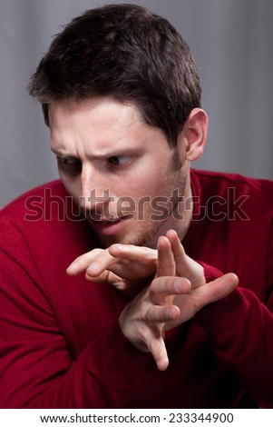 Vertical view of crazy man with depression - stock photo