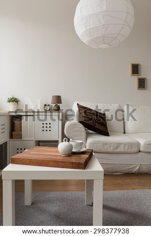 Vertical view of designed living room interior - stock photo