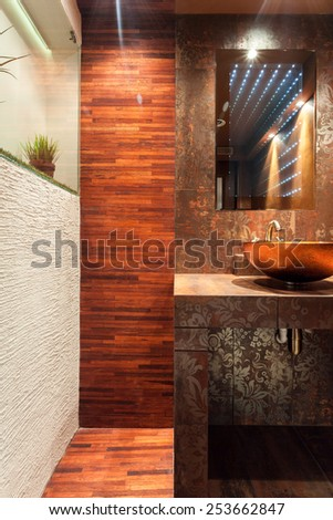Vertical view of expensive interior of bathroom