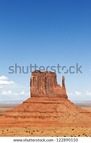 vertical view of famous Monument Valley West Thumb - stock photo