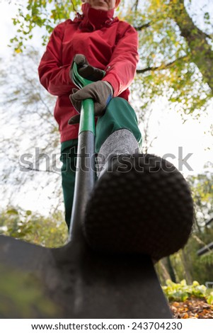 Vertical view of gardener during garden work - stock photo