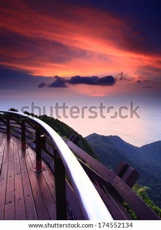 Vertical view of glorious sunset from top of Gunung Mat Chinchang, Langkawi cable car, Kedah, Malaysia - stock photo