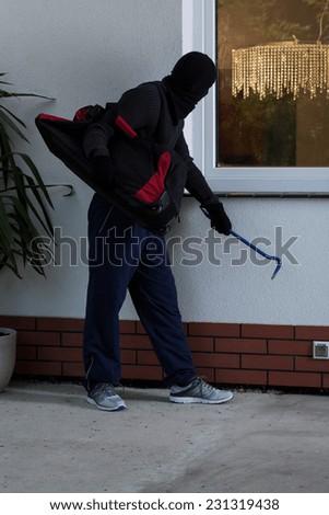 Vertical view of male thief before burglary - stock photo