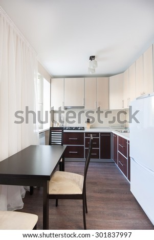 Vertical view of modern furniture in kitchen