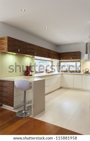 Vertical view of modern kitchen with white counter top - stock photo