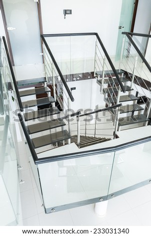 Vertical view of modern staircase at home - stock photo
