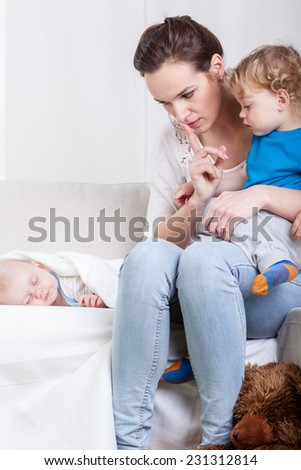 Vertical view of mother and her kids - stock photo