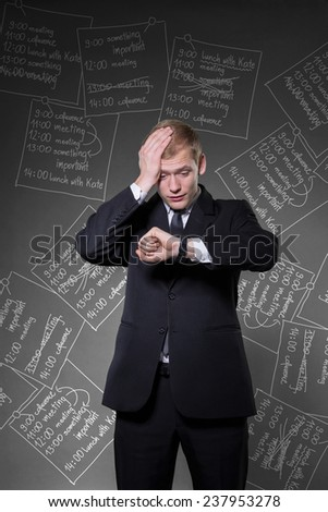 Vertical view of overworked businessman being late - stock photo