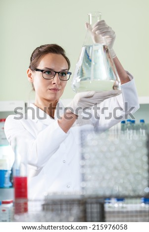 Vertical view of scientist experimenting in laboratory - stock photo