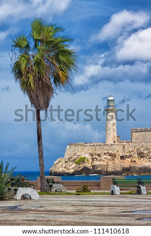 Vertical view of the castle of El Morro, a symbol of Havana, and a nearby romantic park on a day with a beautiful sky - stock photo