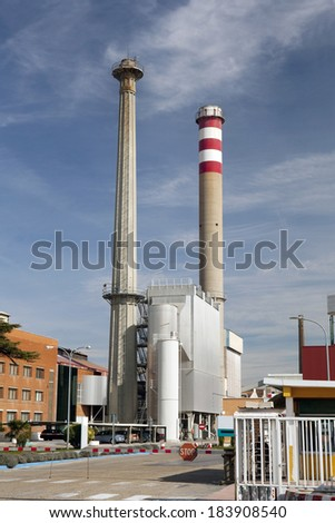 Vertical view of two tall smokestacks in a factory. Smokestacks  - stock photo
