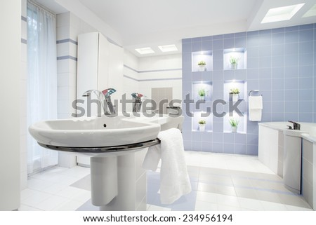 Vertical view of washbasin in white toilet - stock photo