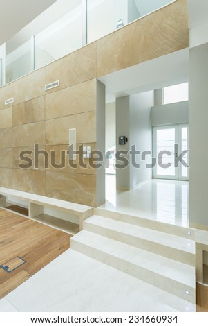Vertical view of white and beige spacious interior - stock photo