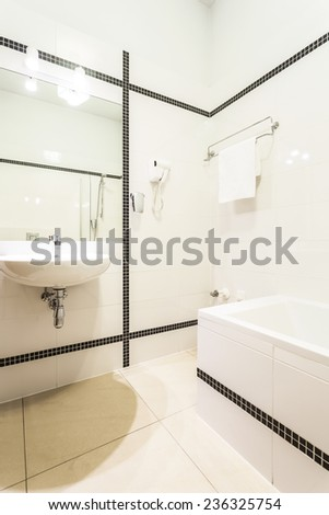 Vertical view of white fresh bathroom interior - stock photo