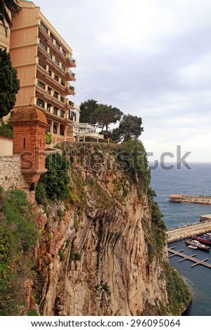Vertical view with building on sea rocks, Monaco, Cote d'Azur, French Riviera - stock photo